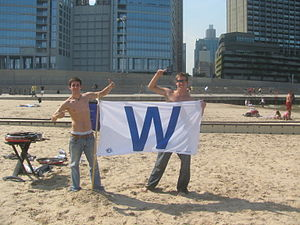 "2008 Chicago Cubs season - With the magic number at 1, fans had their ""Cubs Win"" flags flying in Chicago."
