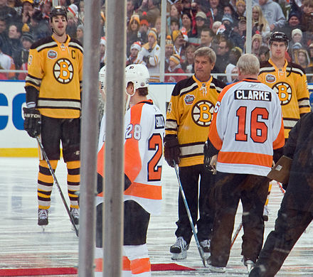 Orr prepares for the ceremonial puck drop with Bobby Clarke prior to the 2010 NHL Winter Classic 2010 winter classic pregame.jpg