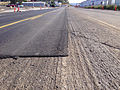 2014-09-09 09 04 58 Asphalt milled in preparation for new asphalt overlay with new overlay partially applied on Idaho Street (Interstate 80 Business and Nevada State Route 535) in Elko, Nevada.JPG