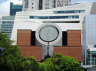San Francisco Museum of Modern Art - The 1995 Mario Botta-designed building with the new white Snøhetta-designed building behind it. (2017)
