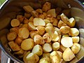 20 Baby potatoes - young potatoes cleaned and cut before cooking - British cuisine.jpg