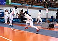 2nd Leonidas Pirgos Fencing Tournament. Foot touch attempt by the fencer on the right against Eleftheria Mimigianni.jpg