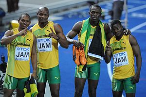 Michael Frater - Frater (left) celebrating the world championship relay victory with his teammates