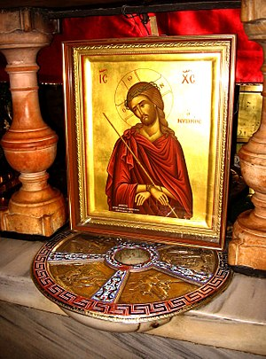 Holy Monday - Icon of Christ the Bridegroom, sitting above the star at Golgotha in the Church of the Holy Sepulchre, Jerusalem.