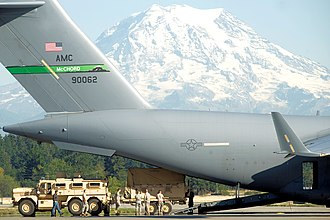 Joint Base Lewis–McChord - 62d AW C-17 loading Army personnel on JBLM McChord Field. Mount Rainier is in the background.