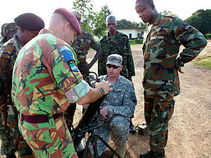 British military intervention in the Sierra Leone Civil War - Soldiers from the British and United States armies training Sierra Leonean soldiers to use a mortar during 2011