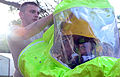 A Soldier helps U.S. Army Staff Sgt. James Languirand with his Level A chemical protective suit during the Hazardous Materials Technician Course culmination exercise at Fort Bragg, N.C., Oct. 18, 2012 121018-A-IA524-868.jpg