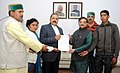 A delegation from Uttarakhand led by the Member of Parliament, Shri Tarun Vijay giving a memorandum to the Minister of State for Development of North Eastern Region (IC), Prime Minister's Office, Personnel.jpg