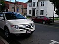A red Honda and a white Ford (2601618908).jpg