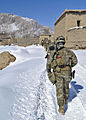 Afghan Local Police (ALP) and coalition troops conduct a patrol in Shah Joy district, Zabul province, Afghanistan, Jan 120127-N-CI175-036.jpg