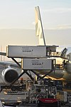 Airline catering trucks from Servair resupply a giant Airbus A380.jpg