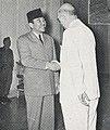 Ambassador John M. Allison shaking hands with President Sukarno, Aneka Amerika 102 (1957), p1.jpg