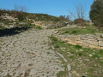 Ambrussum - The paved road in the oppidum at the south gate leading from the Via Domitia, Ambrussum.