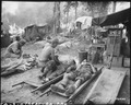 American medics treat casualties at an American portable surgical unit during the 36th Division drive on Pinwe, Burma. - NARA - 531238.tif