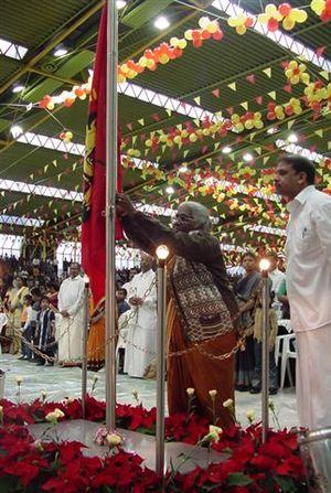 Maaveerar Naal - A mother of a martyred LTTE cadre raises the Tamil Eelam flag on Maaveerar Naal 2002 in Germany