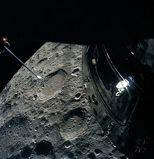 Apollo 13 - The Apollo 13 crew photographed the Moon out of the Lunar Module overhead rendezvous window as they passed by. The deactivated Command Module is visible.