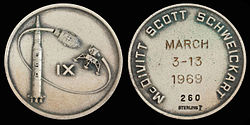 Apollo 9 mission emblem (front). Crew names, flight dates, and serial number 260 (back)