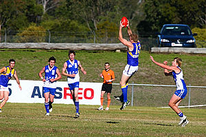 Mark (Australian rules football) - An uncontested overhead mark taken by a player in a suburban western Sydney AFL game between the East Coast Eagles AFC and Campbelltown Kangaroos AFC