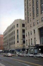 The Art Deco Mayflower Manor Apartment Apartments formerly the Mayflower Hotel. Rising 207 feet, it is an Akron Landmark. Also shown is the Polsky Building. It was once Akron's flagship department store. it is now owned by the University of Akron and houses various departments for the school.