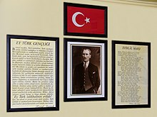 Schoolroom wall with the lyrics of İstiklâl Marşı (far right).
