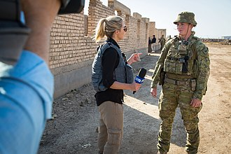 Nine Network - A Nine Network journalist interviewing an Australian soldier in Iraq during 2017