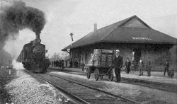 A train arrives at Bardwell's Illinois Central station, circa 1910.
