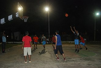 Rangaraya Medical College - Students playing in the renovated basketball court.
