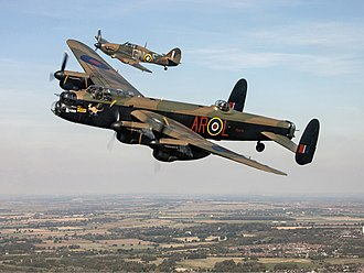Battle of Britain Memorial Flight - Lancaster B I PA474 in 460 Squadron (RAAF) colours, escorted by Hurricane Mk.IIc LF363 in 249 Sqn livery.