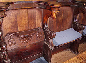 Misericord - With the seat lifted (left), the misericord provides a ledge to support the user