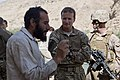 British Army Brig. Paul Nanson, center, the deputy commander of Regional Command Southwest, speaks with a worker during a trip to the Kajaki Dam in Helmand province, Afghanistan, Oct. 2, 2013 131002-M-RF397-186.jpg
