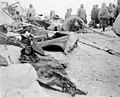 Butchered whale on snowy beach with Eskimos in background, Seward Peninsula, Alaska, between 1908 and 1915 (AL+CA 6421).jpg