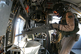 Boeing Vertol CH-46 Sea Knight - A door gunner manning a pintle-mounted .50-caliber M2 machine gun aboard a Marine CH-46, August 2006