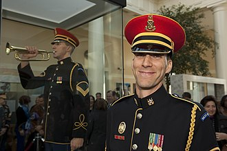 """United States military music customs - In 2013 a lifelike statue of U.S. Army Band bugler Sgt. Jesse Tubb playing """"Taps"""" was unveiled in the visitors' center of Arlington National Cemetery."""