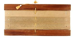 Palm-leaf manuscript - A palm leaf Hindu text manuscript from Bali, Indonesia, showing how the manuscripts were tied into a book.