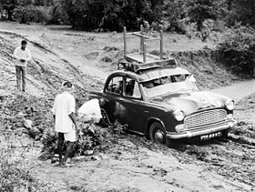 Car stuck in mud, Mangal Tarai, India, 1973 (16880601509).jpg