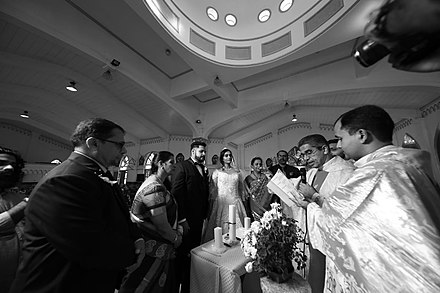 Priest reading the blessing at a Catholic wedding, 2018 Catholic wedding blessing.jpg