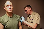 Cherry Point leaders receive flu shots 141031-M-BN069-003.jpg