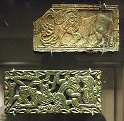 Chinese jade and steatite plaques, in the Scythian-style animal art of the steppes. 4th–3rd century BC. British Museum.