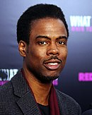 Photo of Chris Rock attending the premiere of the 2012 film What to Expect When Your Expecting.