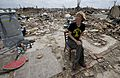 Christie England, an acquisition law paralegal with the 72nd Air Base Wing, based at Tinker Air Force Base, Okla., sits amid the remains of her home in Moore, Okla., May 27, 2013, a week after an EF5 tornado 130527-F-IE715-161.jpg