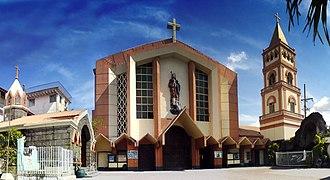 Biñan - San Isidro Labrador Parish Church, located at the downtown city plaza of Barangay Poblacion.