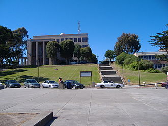 City College of San Francisco - Science Building atop Cloud Hill as viewed from Ram Plaza (the Quad); a CCSF police car patrols along Cloud Circle.