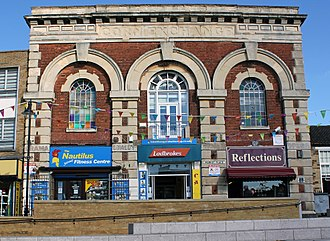Kettering - Corn Exchange, Market Square, Kettering, 1853 by E. F. Law. The upper floor was designed as a Town Hall. In use October 2012 as fitness centre and betting shop. The building is not listed.
