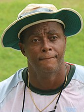 Courtney Walsh wearing a cricket cap
