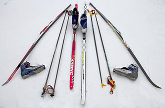 Ski - Modern cross-country skis from synthetic materials, with poles and shoes.