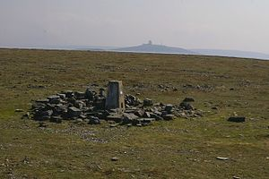 Cross Fell - The summit of Cross Fell with Great Dun Fell and its radar station in the background. The object in the centre foreground is a triangulation point