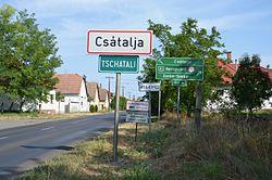 Csátalja (Tschatali) - bilingual city limit sign.JPG