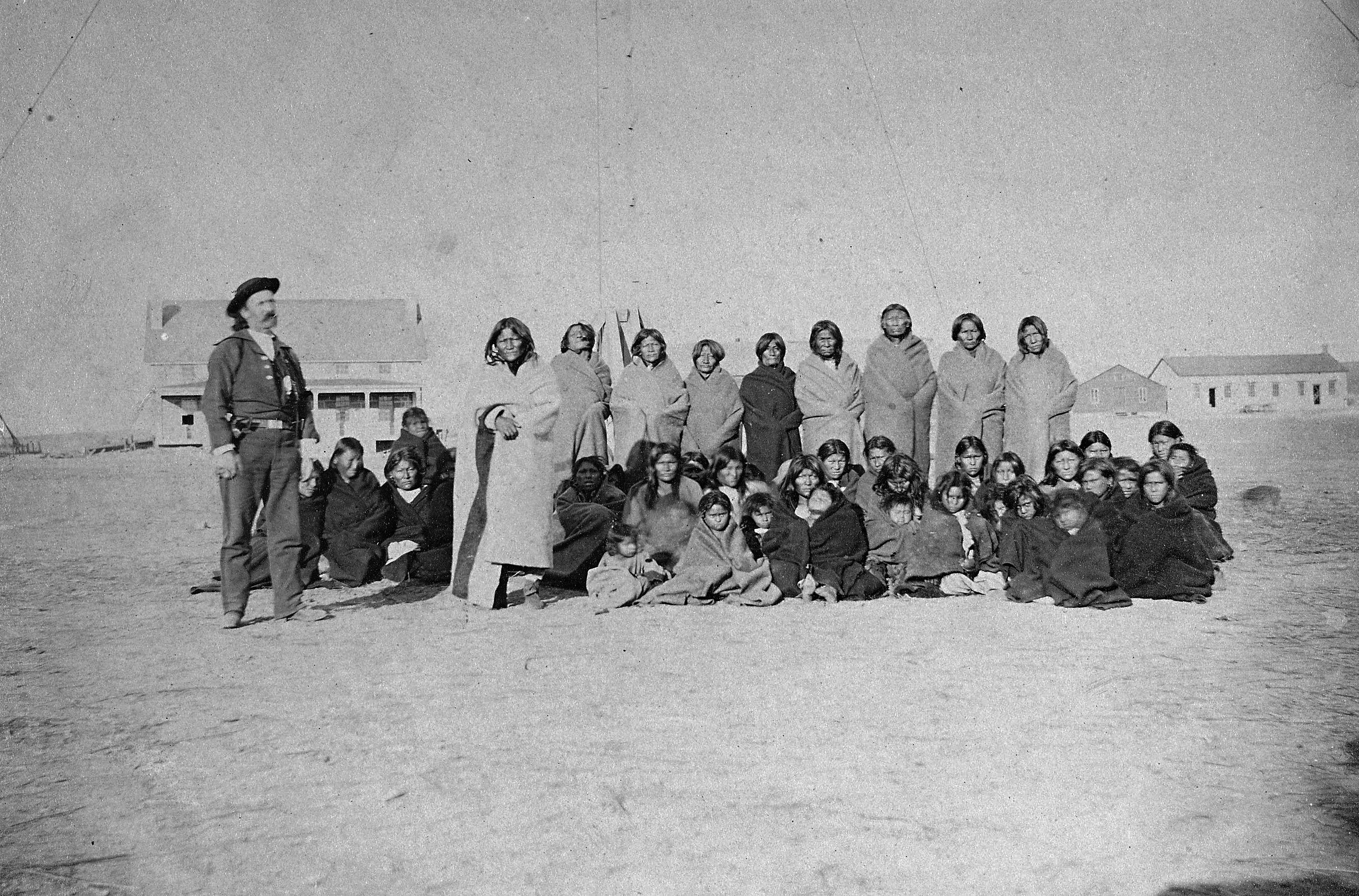 Cheyenne captives, taken at Fort Dodge, Kansas en route to the stockade at Fort Hays; to the left stands U.S. Army chief of scouts John O. Austin.