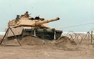 Marine Corps Base Camp Pendleton - An M1 Abrams breaches the obstacle belt during an amphibious exercise in 1997.