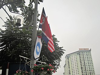 2019 North Korea–United States Hanoi Summit - US, North Korea and Vietnam flags on Nguyen Chi Thanh street.